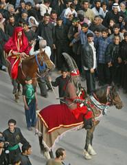 IRAQI SHI'ITE MEN DRESSED AS ANCIENT ISLAMIC WARRIORS RIDE HORSES IN KERBALA.