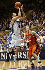 Duke University's McClure goes to the basket against Clemson's Tyler in Durham
