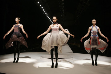 Models display creations by Turkish-Cypriot designer Hussein Chalayan as part of his Fall/Winter 2007/2008 ready-to-wear fashion show in Paris