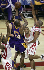 Los Angeles Lakers guard Bryant is defended as he tries to score in Game 6 of NBA Western Conference semi-final playoff basketball game in Houston