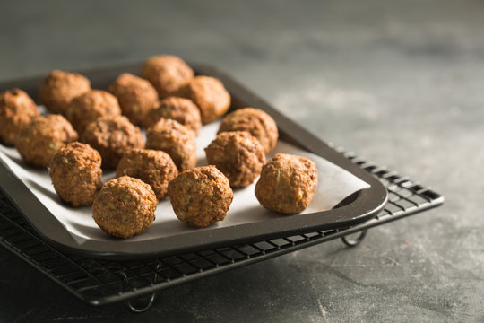 Close up of meatballs in a baking tray