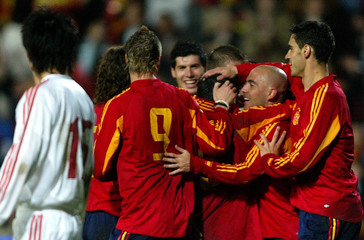 Spain's players celebrate after scoring against China during their international friendly soccer ...