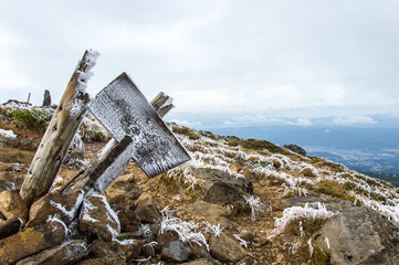 Frozen sign on a foggy day in Zao Mountain Range, Japan
