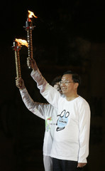 Taiwan's President Chen Shui-bian holds a torch in Taipei