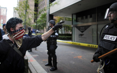 A protester points at a policeman during a march at the G20 Summit in Pittsburgh