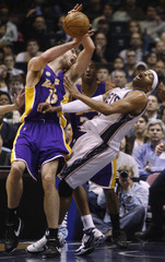 New Jersey Nets guard Carter is fouled by Los Angeles Lakers forward Gasol in the first quarter of their NBA basketball game in East Rutherford