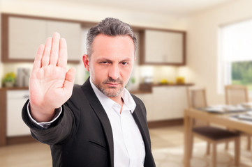 Serious realtor showing stop gesture
