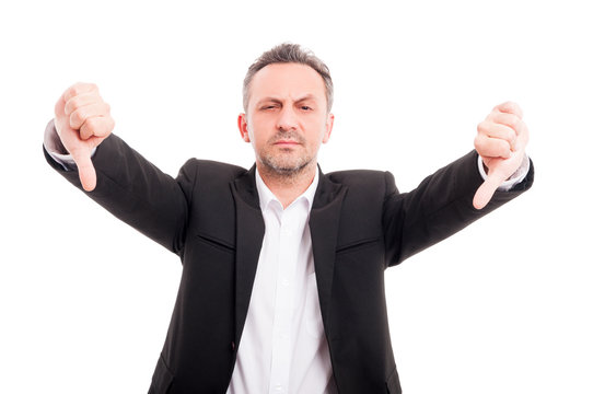Businessman doing double thumb down gesture