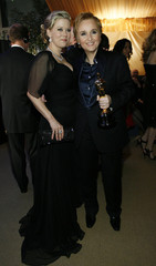 Melissa Etheridge (R) poses with the Oscar for best original song for 'I Need to Wake Up' from the motion picture 'An Inconvenient Truth' with partner Lynn Michaels at the 79th Annual Academy Awards Governors Ball in Hollywood, California