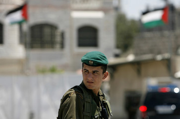 Member of the Palestinian presidential guard stands outside Abbas' headquarters in Ramallah