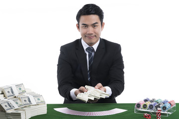The dealer presenting banknotes in hand from gambling