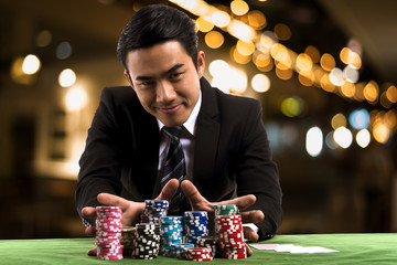 Portrait the poker Player used hands push stack chips forward to betting