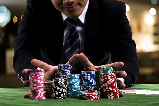 A poker Player used hands pushing in all his chips to betting