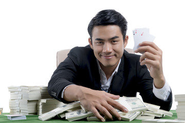 Happy poker player winning and holding set of aces