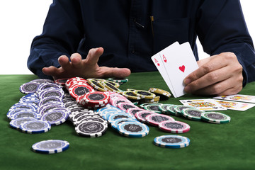 The winning gambler hand grabbing a pile of chips