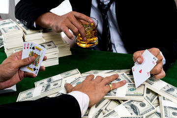 The gambler poker and the bets big pile