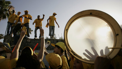 Supporters of the Popular Movement (PM) sing during a campaign rally in Rabat