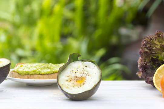 Healthy food. Vegan sandwiches with fresh avocado on wooden background,Close up egg.