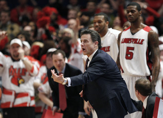 Louisville Cardinals coach Pitino directs his team during the championship game against the Syracuse Orange at the 2009 NCAA Big East men's college basketball tournament in New York