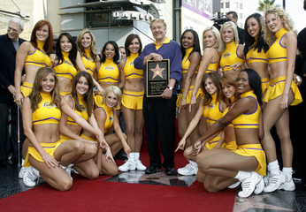 Buss and Laker Girls pose as Los Angeles Lakers owner Jerry Buss receives a star on the Hollywood Walk of Fame in Hollywood