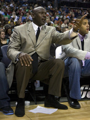 Charlotte Bobcats part owner Michael Jordan argues with an official as his team plays the Boston Celtics during an NBA basketball game at Time Warner Cable Arena in Charlotte