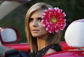 Heidi Klum poses at Barbie's 50th birthday party at the Barbie real-life Malibu Dream House in Malibu