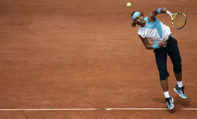 Spain's Rafael Nadal serves to Fabrice Santoro from France during an exhibition match in Paris