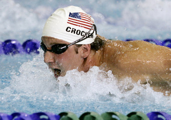 Crocker of the U.S. swims men's 100m butterfly heat at Pan Pacific swimming championships in Victoria