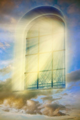 Mystical magic window with divine rays of light and mystic cloudy sky like a spiritual background with sunrise