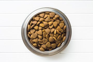 Dry kibble dog food in bowl.
