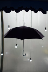 umbrella with fall rain and light. idea concept. black and white