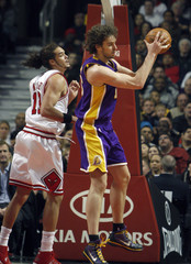 Lakers Gasol grabs a rebound against the Bulls during their game in Chicago