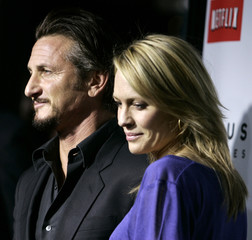 """Cast member Sean Penn and his wife Robin Wright Penn arrive for the premiere of the film """"Milk"""" in Beverly Hills"""