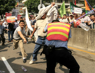 Protesters clash with police during a Labour Day march in Macau