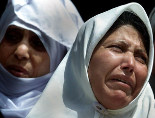 PALESTINIAN MOTHER CRIES DURING HER SON'S FUNERAL IN GAZA STRIP.