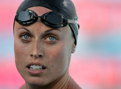 Amanda Beard steps out of the pool after winning the 100 meter breaststroke final in a time of one m..