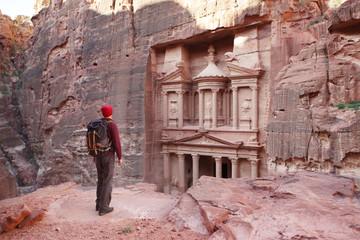 Petra, Traveler looking at the Treasury. Jordan.