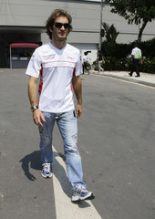 Toyota Formula One driver Jarno Trulli of Italy arrives at the Marina Bay Singapore F1 Grand Prix circuit
