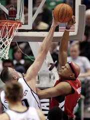 Utah Jazz Ostertag blocks a shot by Toronto Raptors Villanueva during the second half of NBA action in Salt Lake City