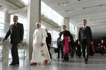 Pope Benedict XVI walks down the corridor at the Pope John Paul II Cultural Center as he attends an Interreligious Gathering in Washington