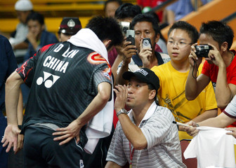 INDONESIAN BADMINTON FANS TAKE A PICTURES OF CHINA PLAYER DAN LIN DURING THOMAS CUP IN JAKARTA.