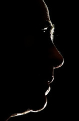 MCCAIN IS SILHOUETTED AS HE SPEAKS AT SACRED HEART UNIVERSITY.