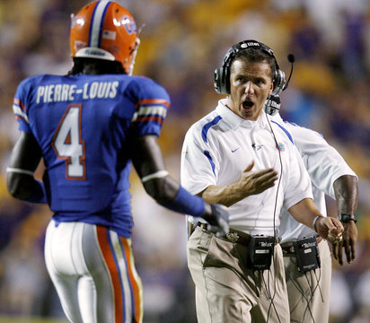 University of Florida head coach Meyer screams at Pierre-Louis after a play in the second quarter of their NCAA football game against Louisiana State University in Baton Rouge