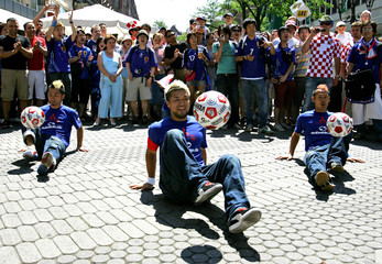 Soccer fans of Japan play with soccer balls in the centre of  Nuremberg before the World Cup soccer between Japan and Croatia