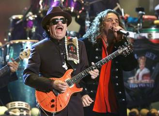 "Legendary guitarist Carlos Santana and Mana lead singer Fernando Olvera (R) perform ""Corazon Espinad.."