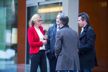 Businesspeople talking in street