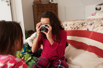 Girl photographing friend