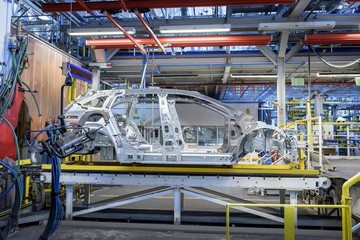 View of cars on production line in factory