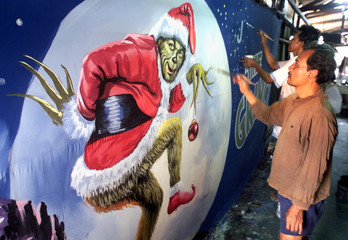 "INDONESIAN ARTISTS PAINT A BILLBOARD FOR UPCOMING RELEASE OF JIM CARREY'S ""GRINCH"" COMEDY IN JAKARTA."