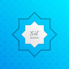 Eid Mubarak card with paper cut effect. Arabesque pattern and typography